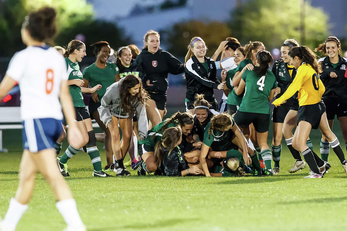 The Reagan Lady Rattlers celebrate their 2-1 overtime victory over Brandesis in their Class 5A second round playoff game at Northside ISD field No. 1 on Friday, April 5, 2013. Photo by Marvin Pfeiffer / Prime Time Newspapers