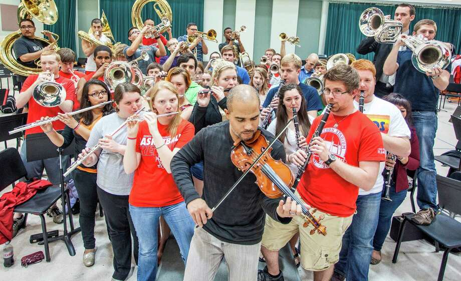 Violinist and composer Daniel Bernard Roumain, center, and members of the UH Spirit of Houston Marching Band gear up for the performance. Photo: David A. Brown/dabfoto