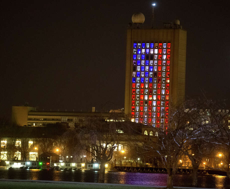 A building on the campus of MIT in Cambridge, Mass. was lit up like an American Flag after two explosions went off near the finish line of the 117th Boston Marathon on April 15, 2013. Photo: Boston Globe, Boston Globe Via Getty Images / 2013 - The Boston Globe
