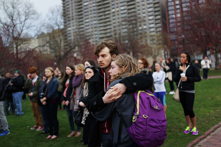 A couple hugs during a vigil for victims of the Boston Marathon bombings at Boston Commons on April 16, 2013 in Boston, Massachusetts. The twin bombings, which occurred near the marathon finish line, resulted in the deaths of three people while hospitalizing at least 140. The bombings at the 116-year-old Boston race, resulted in heightened security across the nation with cancellations of many professional sporting events as authorities search for a motive to the violence. Photo: Spencer Platt, Getty Images / 2013 Getty Images