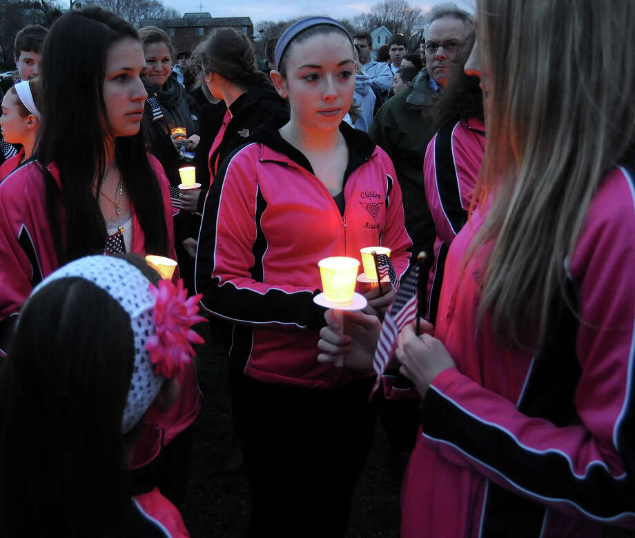 Students from the Clifden Academy hold an American flag and candles during a vigil ceremony April 16, 2013  in Dorcester, Massachusetts, honoring the Richard family, who's 8-year-old son Martin was killed,  and sister Jane, who lost a leg and had danced at the school, and mother Denise, who was also seriously injured when bombs exploded at the finish of the Boston Marathon April 15th. Photo: JOHN MOTTERN, AFP/Getty Images / 2013 AFP