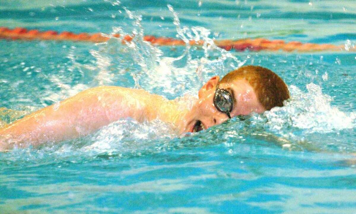 New Milford's Mike LaDelfa swims the 500 free during the swim meet at Southbury High School Jan. 6, 2010.