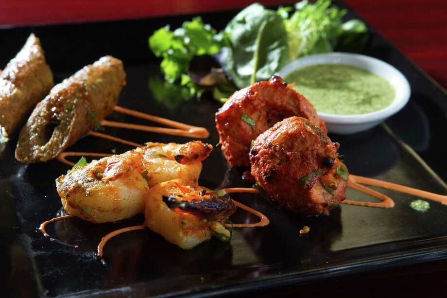 The appetizer plate at Great W'kana includes lamb sheekh kebab, Peshawari chicken tikka and Nilaufari Jhinga (shrimp). Photo: Brett Coomer, Staff / Houston Chronicle