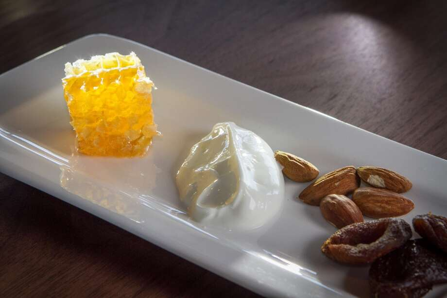 Local honey served in its comb, with Straus yogurt, Turkish apricots and almonds at Seaglass.