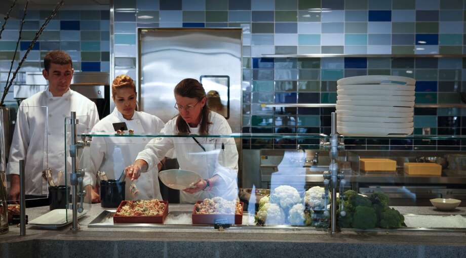 Chef Loretta Keller, right, trains members of Seaglass.