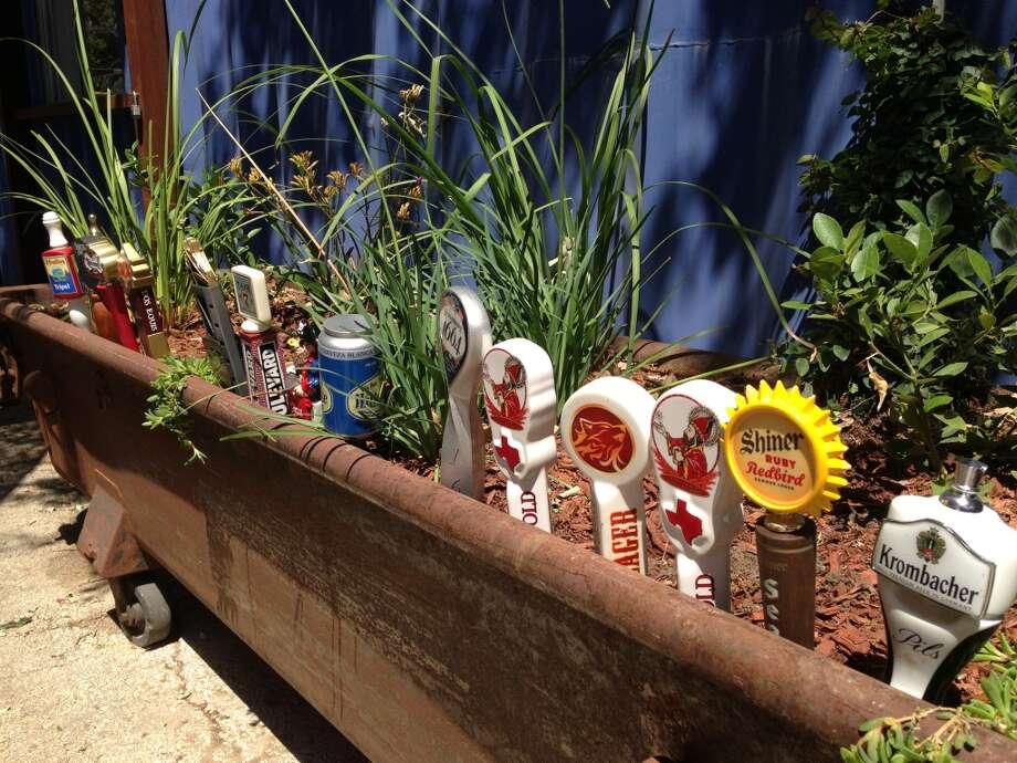 Tap handles decorates a garden trough.