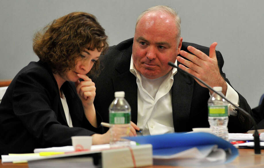 Michael Skakel, right, speaks to Jessica Santos, one of his defense attorneys, at Skakel's habeas corpus hearing at State Superior Court in Rockville, Conn., on Wednesday, April 17, 2013. Photo: Jason Rearick / Stamford Advocate