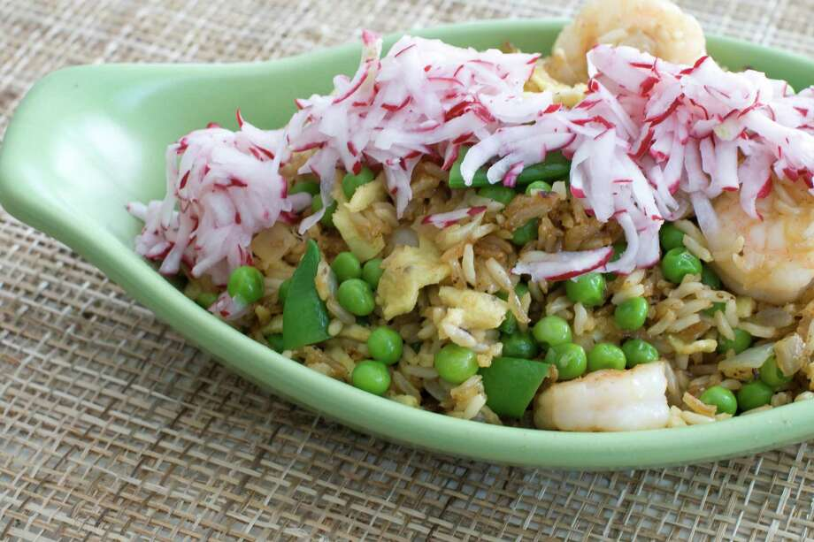 In this image taken on April 8, 2013, shrimp fried rice with pickled radishes is shown in Concord, N.H. (AP Photo/Matthew Mead) Photo: Matthew Mead