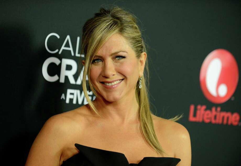 "Jennifer Aniston arrives at the world premiere of ""Call Me Crazy: A Five Film"" at the Pacific Design Center on Tuesday, April 16, 2013 in Los Angeles. (Photo by Jordan Strauss/Invision/AP) Photo: Jordan Strauss"