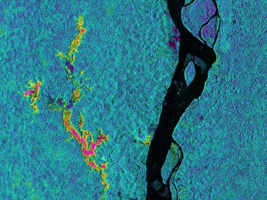 On March 17, 2013, NASA's Uninhabited Aerial Vehicle Synthetic Aperture Radar (UAVSAR) acquired synthetic aperture radar data over the Napo River in Ecuador and Peru. The image colors indicate the likelihood of inundation (flooding) beneath the forest canopy, which is difficult to determine using traditional optical sensors. Red and yellow shades indicate a high likelihood of standing water with emergent vegetation, blue and green shades are areas less likely to be inundated, and black indicates the open water areas of the Napo River. These data, which have already been transmitted to a field team working along the Napo River, will be used to guide field measurements during a second observation by UAVSAR on March 31, 2013. The image is a 8.7-mile-wide by 5.6-mile-long (14-kilometer-wide by 9-kilometer-long) segment of an image measuring more than 124 miles (200 kilometers) long. North is toward the upper right. The resolution is 20 feet (6 meters). UAVSAR data like these are helping scientists assess the effectiveness of using synthetic aperture radar data to study the inundation dynamics of this and similar rivers around the world. Photo: NASA