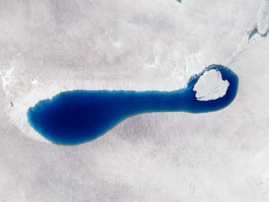 Each spring and summer, as the air warms up and the sunlight beats down on the Greenland ice sheet, sapphire-colored ponds spring up like swimming pools. As snow and ice melt atop the glaciers, the water flows in channels and streams and collects in depressions on the surface that are sometimes visible from space. These melt ponds and lakes sometimes disappear quickly - a phenomenon that scientists have observed firsthand in recent years.  Photo: NASA