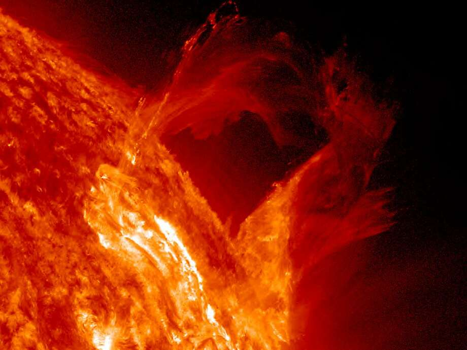 A solar prominence began to bow out and the broke apart in a graceful, floating style in a little less than four hours (Mar. 16, 2013). The sequence was captured in extreme ultraviolet light. A large cloud of the particles appeared to hover further out above the surface before it faded away. Credit: Solar Dynamics Observatory/NASA Photo: NASA