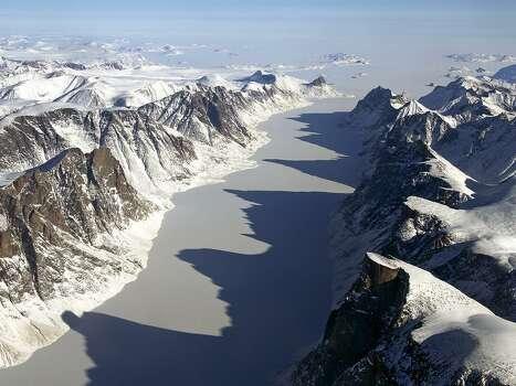 IceBridge Flight Over Baffin Island: The image captures ice covered fjord on Baffin Island with Davis Strait in the background.   Image Credit: NASA/Michael Studinger Photo: NASA