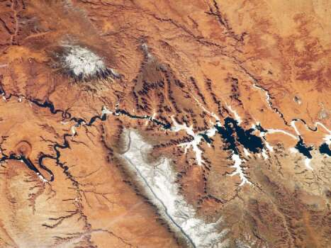 The Colorado Plateau spans northern Arizona, southern Utah, northwestern New Mexico, and southwestern Colorado. This physiographic province is well known for its striking landscapes and broad vistas—an impression that is enhanced by the view from the orbital perspective of the International Space Station. This astronaut photograph highlights part of the Utah-Arizona border region of the Plateau, and includes several prominent landforms. Photo: NASA