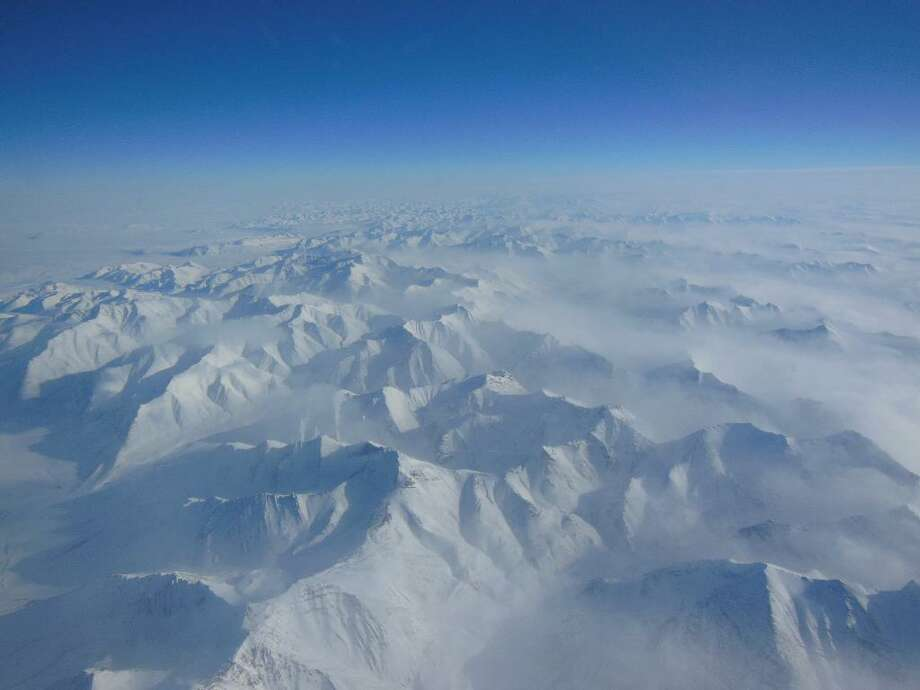 Alaskan mountains seen from high altitude aboard the NASA P-3B during the IceBridge transit flight from Thule to Fairbanks on March 21, 2013. NASA's Operation IceBridge is an airborne science mission to study Earth's polar ice. Photo: NASA