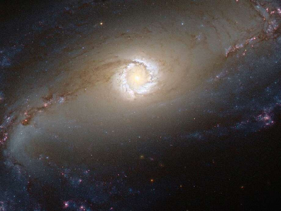 The Hubble Space Telescope captured a spectacular image of the bright star-forming ring that surrounds the heart of the barred spiral galaxy NGC 1097. In this image, the larger-scale structure of the galaxy is barely visible: its comparatively dim spiral arms, which surround its heart in a loose embrace, reach out beyond the edges of this frame. Photo: NASA