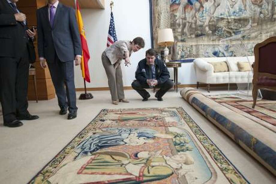 Immigration and Customs Enforcement personnel, return a 16th century tapestry, stolen from a Spanish national cathedral in 1979, to the people of Spain. The tapestry was seized by U.S. Immigration and Customs Enforcement's (ICE) Homeland Security Investigations (HSI) special agents in Houston. Photo: U.S. Immigration & Customs