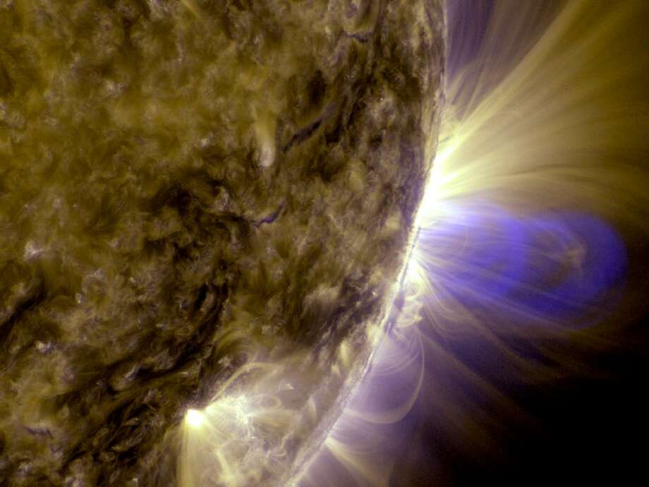 This is an image of magnetic loops on the sun, captured by NASA's Solar Dynamics Observatory (SDO). It has been processed to highlight the edges of each loop to make the structure more clear.