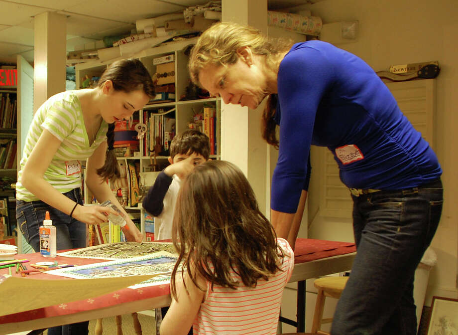 Elizabeth Devoll, education director at the Westport Historical Society, works with students on an art project Tuesday offered during the schooll vacation week. Photo: Jarret Liotta / Westport News contributed
