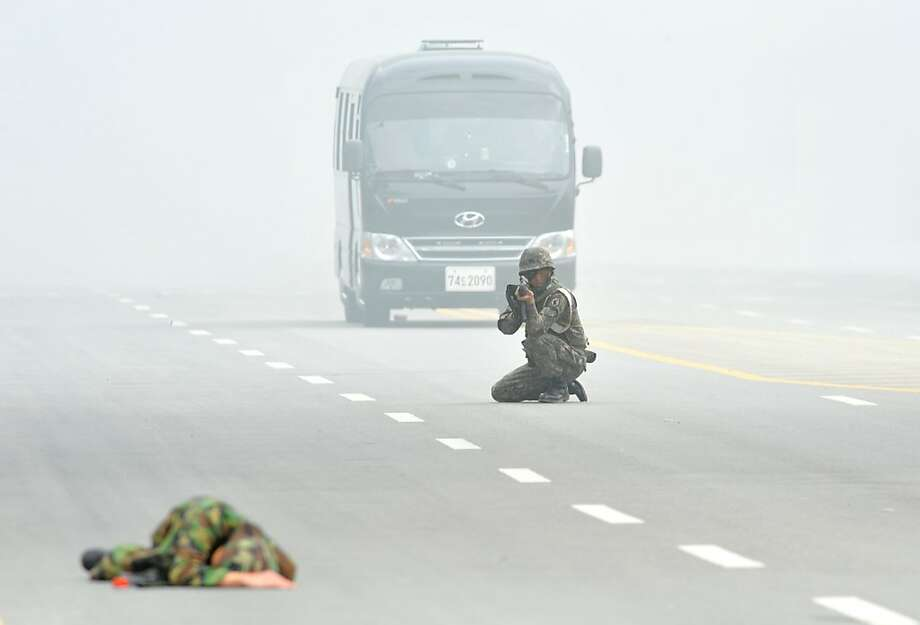War games: A soldier playing a North Korean guerrilla pretends to be dead during a South Korean Army drill at the Integrated Government Complex in Sejong, south of Seoul. Photo: Kim Jae-Hwan, AFP/Getty Images