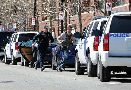 Homeland Security, U.S. Marshals, and the Boston Police Department evacuate the John Joseph Moakley United States Courthouse on April 17, 2013 in Boston, Massachusetts. Media had gathered at the courthouse amid conflicting reports on whether or not a suspect in the Boston Marathon bombings had been identified. The twin bombings, which occurred near the finish line of the 116-year-old Boston race on April 15, resulted in the deaths of three people with more than 170 others injured. Photo: Jared Wickerham, Getty Images / 2013 Getty Images