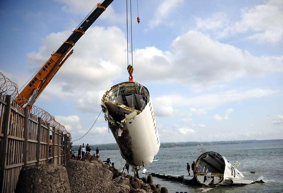 How do you get a crashed Boeing 737 off a beach? By cutting it into pieces and lifting them individually with a crane. The Lion Air Boeing 737 belly-flopped in the water while trying to land at Bali's international airport near Denpasar. Dozens were injured but no one killed in the accident. Photo: Sonny Tumbelaka, AFP/Getty Images