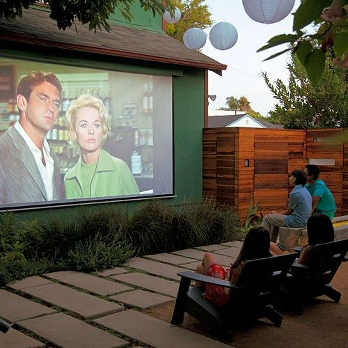HAVE A MOVIE MARATHON Take the fun of Netflix outdoors, and invite your friends and family over for a movie marathon. If you find yourself with a projector, you can always hang up a white bed sheet or have the screen project onto the side of your house.