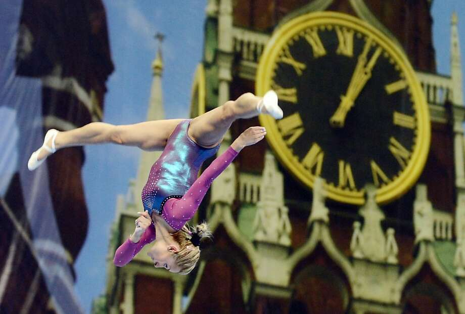 The hands on the clock on the Kremlin's Spasskaya Tower says it's a little after one, but the legs on the gymnast make it quarter to three. The 5th European Artistic Gymnastic Individual Championships began Wednesday in Moscow. Photo: Natalia Kolesnikova, AFP/Getty Images