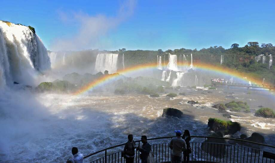 Whenever the sun shines, there's a good chance that a rainbow will arc over Iguazu Falls in Iguazu National Park. The park, shared by Brazil and Argentina, boasts of a spectacular canyon of 275 waterfalls that reach heights of 80 meters. Photo: Norberto Duarte, AFP/Getty Images