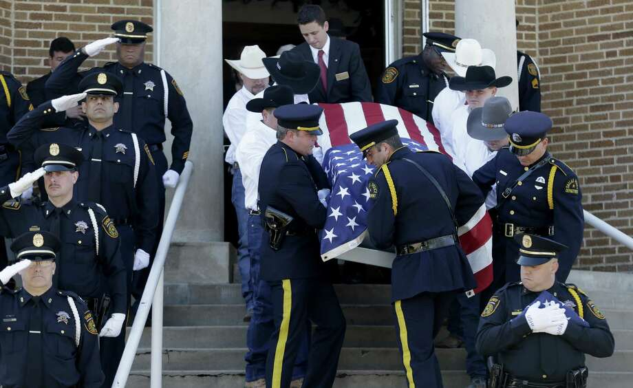 Pallbearers attend to the remains of Kaufman County District Attorney Mike McLelland and wife Cynthia.  If McLelland, trained in handling guns, could not protect himself, a reader asks, what chance do others have? Photo: LM Otero, Associated Press