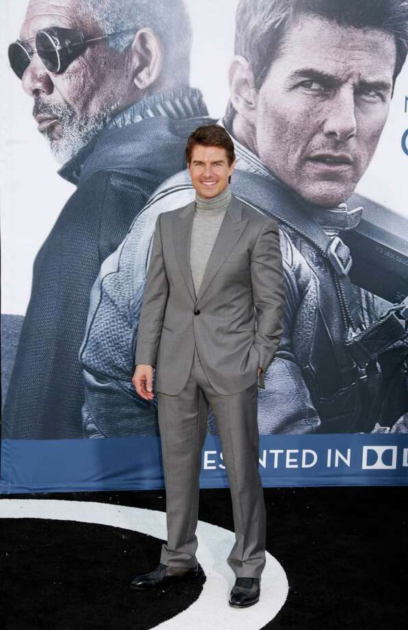 "Tom Cruise arrives at the LA premiere of ""Oblivion"" at the TCL Chinese Theater on Wednesday, April 10, 2013 in Los Angeles. (Photo by Todd Williamson/Invision/AP) Photo: Todd Williamson"