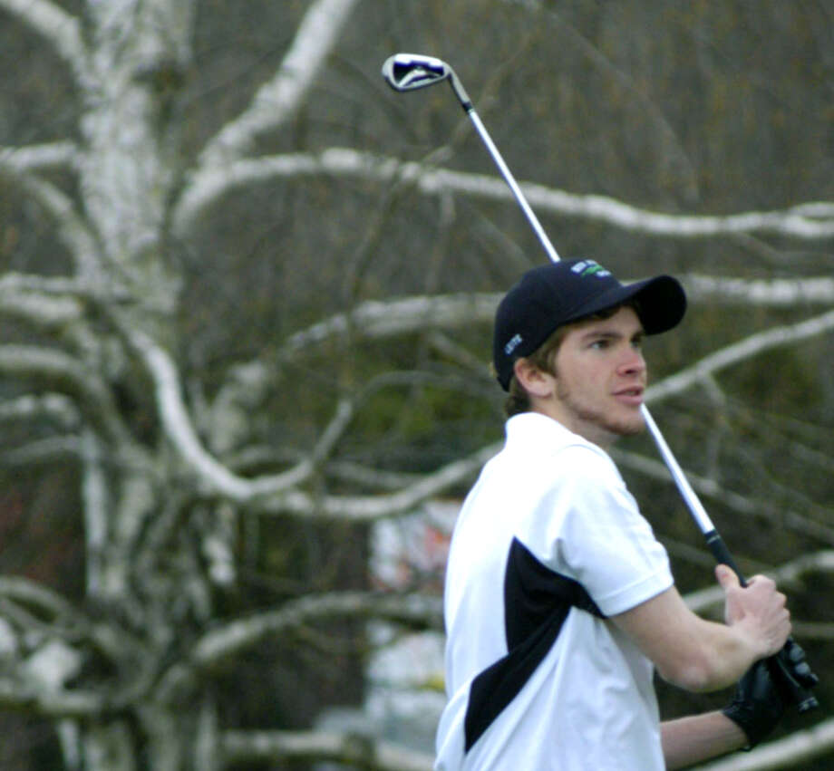 Sandro Leite of the Green Wave follows the progress of an iron shot to the 1st green at at Candlewood Valley Country Club for New Milford High School golf. April 2013 Photo: Norm Cummings
