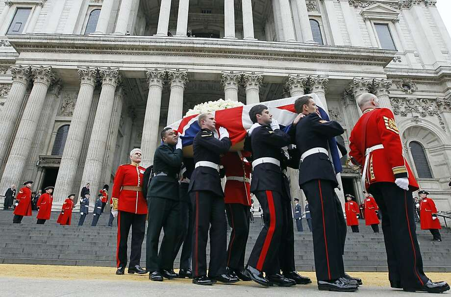 Former British Prime Minister Margaret Thatcher's coffin is carried by pallbearers out from St Paul's Cathedral, following the ceremonial funeral service in London, Wednesday, April 17, 2013. Thatcher, who died, at the age of 87 on 8 April, has been accorded a ceremonial funeral with military honours, one step down from a state funeral, Thatcher was elected Prime Minister on May 4, 1979 and she resigned on Nov. 28, 1990, after eleven years in office. (AP Photo/Alastair Grant) Photo: Alastair Grant, Associated Press
