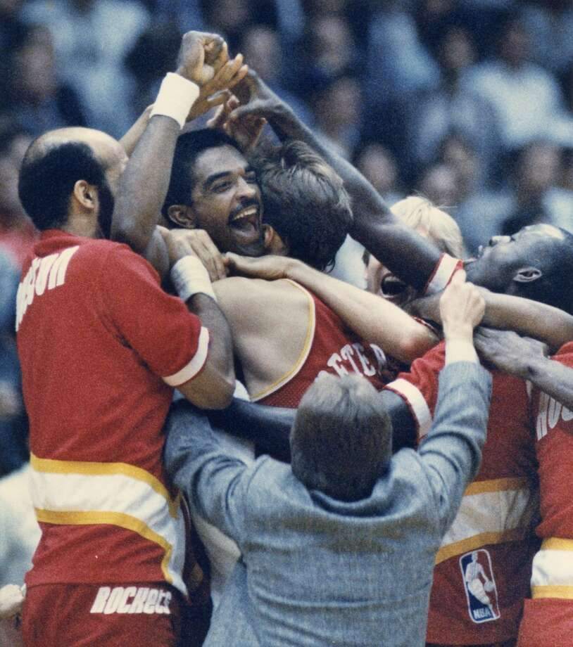 1986 Western Conference Finals Ralph Sampson is mobbed by teammates after his improbable, buzzer-beating shot finished off the Lakers and sent the Rockets to the NBA Finals. Photo: Houston Chronicle File Photo