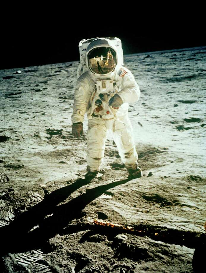 FILE - In this July 20, 1969 file photo from NASA,  Astronaut Edwin E. Aldrin Jr., lunar module pilot, is photographed walking near the lunar module during the Apollo 11 extravehicular activity. (AP Photo, NASA ,file) Photo: NEIL ARMSTRONG, HO / NASA