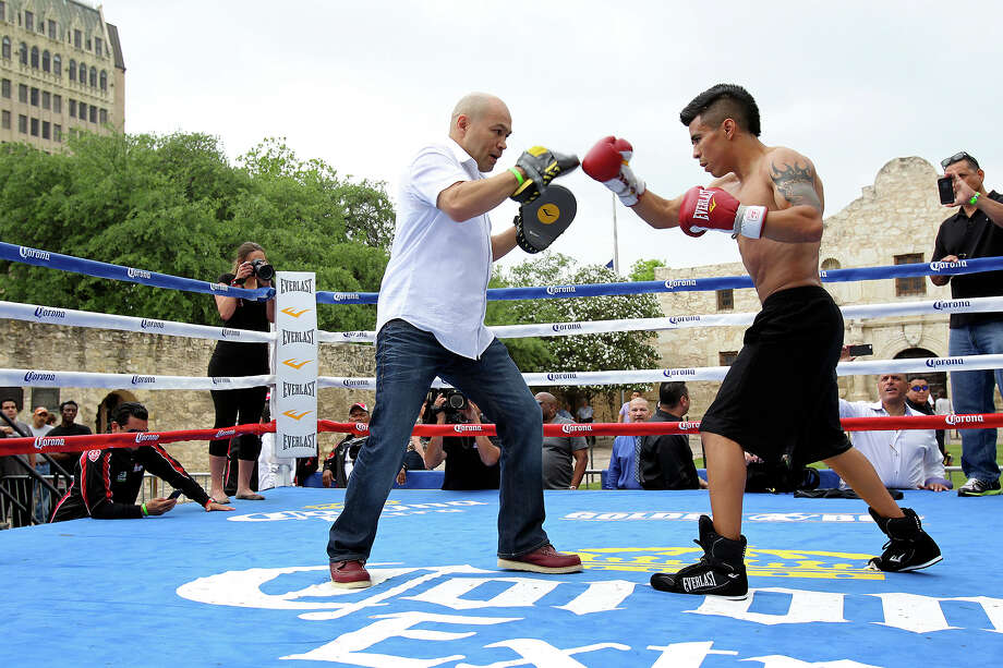 Jesse James Leija works out with Raul Martinez at another boxing promotion in front of the Alamo in April. Texas Land Commissioner Jerry Patterson opposes using The Alamo as a site for a press conference Monday promoting a pay-per-view boxing match. Photo: TOM REEL