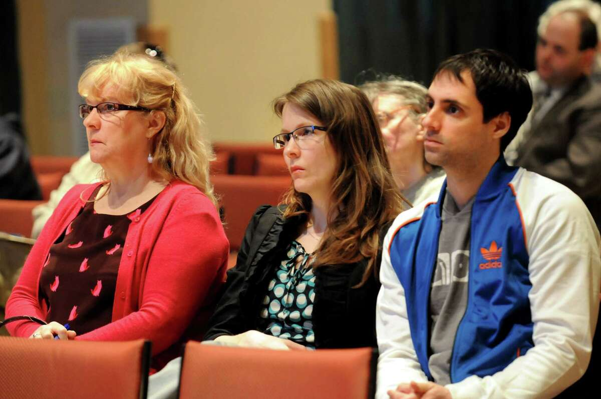Janice Irwin, left, her daughter Cori Irwin, center, and Cori's fiance Nathan Frank, all of Albany, listen during a public forum to address the issue of pedestrian safety in the Capital Region on Wednesday, April 17, 2013, at the Linda, WAMC?s Performing Arts Studio, in Albany, N.Y. Cori's father was hit and killed by a motorist on Central Avenue in Nov. 2011. (Cindy Schultz / Times Union)