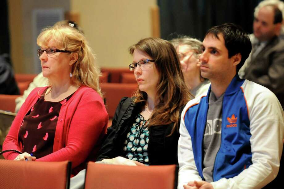 Janice Irwin, left, her daughter Cori Irwin, center, and Cori's fiance Nathan Frank, all of Albany, listen during a public forum to address the issue of pedestrian safety in the Capital Region on Wednesday, April 17, 2013, at the Linda, WAMC?s Performing Arts Studio, in Albany, N.Y. Cori's father was hit and killed by a motorist on Central Avenue in Nov. 2011. (Cindy Schultz / Times Union) Photo: Cindy Schultz / 10021958A