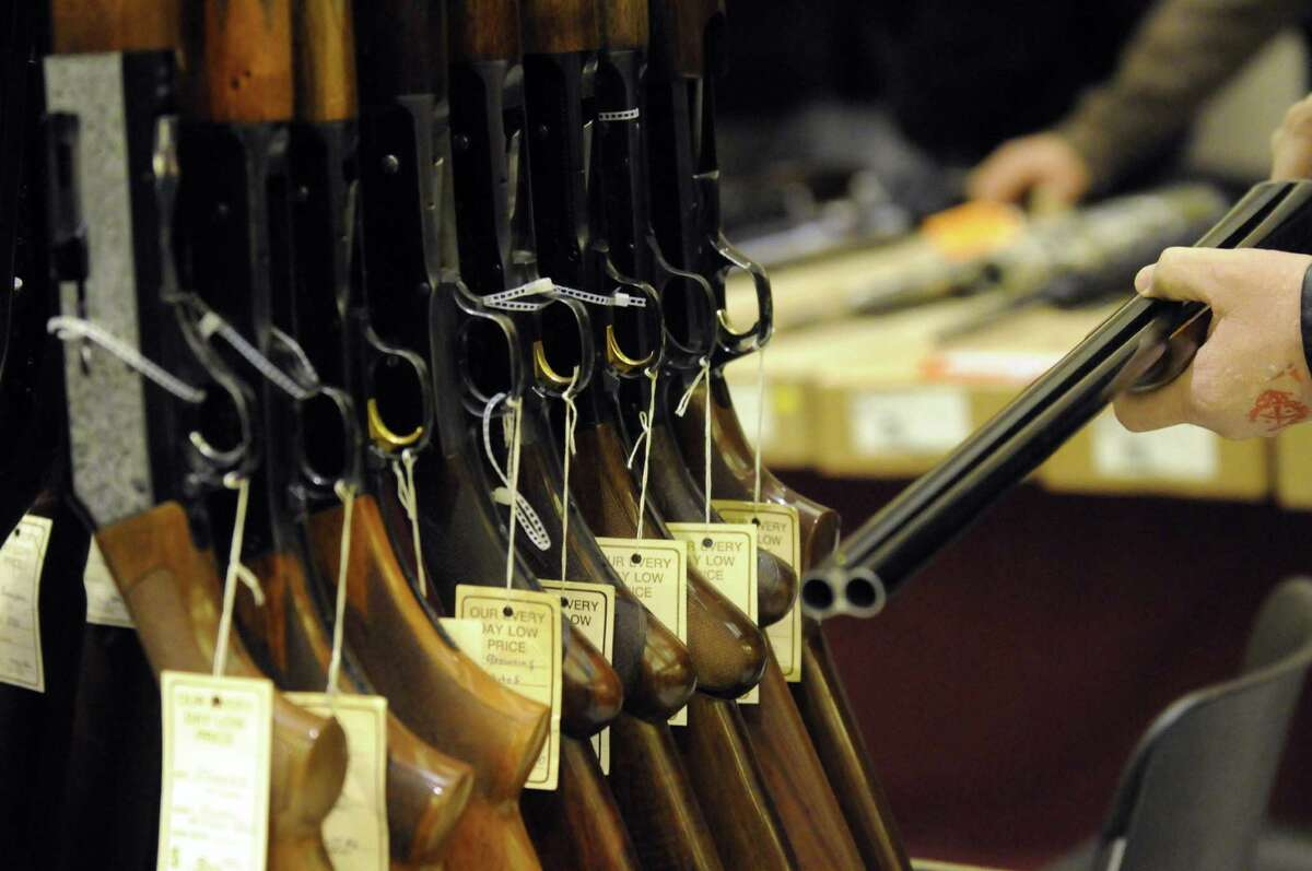Firearm enthusiast look over the offerings at the Saratoga Springs gun show on Saturday Jan. 12,2013 in Saratoga Springs, N.Y. (Michael P. Farrell/Times Union)