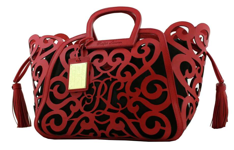Ralph Lauren sent out matador- and flamenco-chic looks on his spring 2013 runway, along with complementary accessories such as the bold new Red Calf RL Signature Scroll Tote; $2,500 at Ralph Lauren in the Galleria and ralphlaurencollection.com. Photo: Unknown / Ralph Lauren Collection