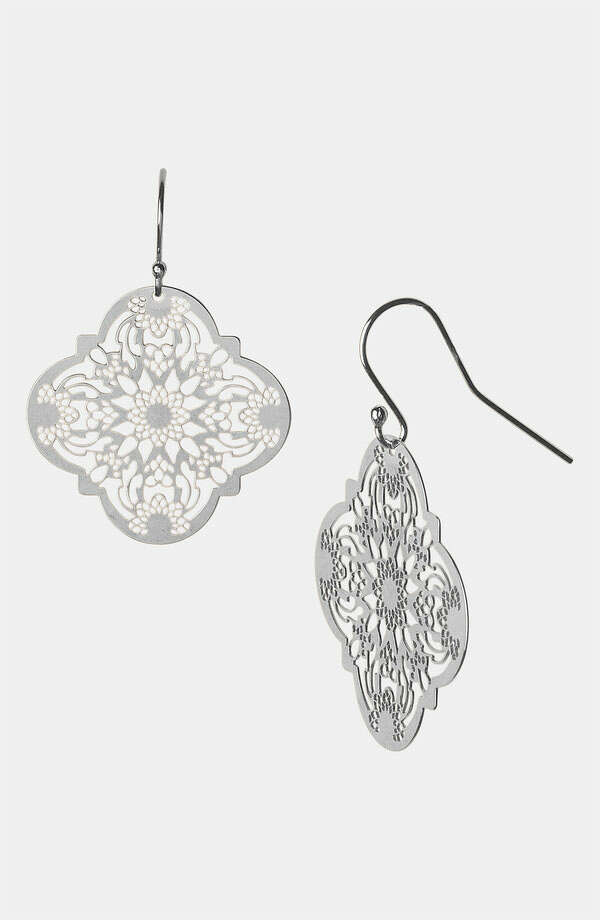 When paired with bold colors, the delicate, lacelike pattern of these sterling silver earrings by Argento Vivo balance the look with Old World elegance; $78 at Nordstrom.
