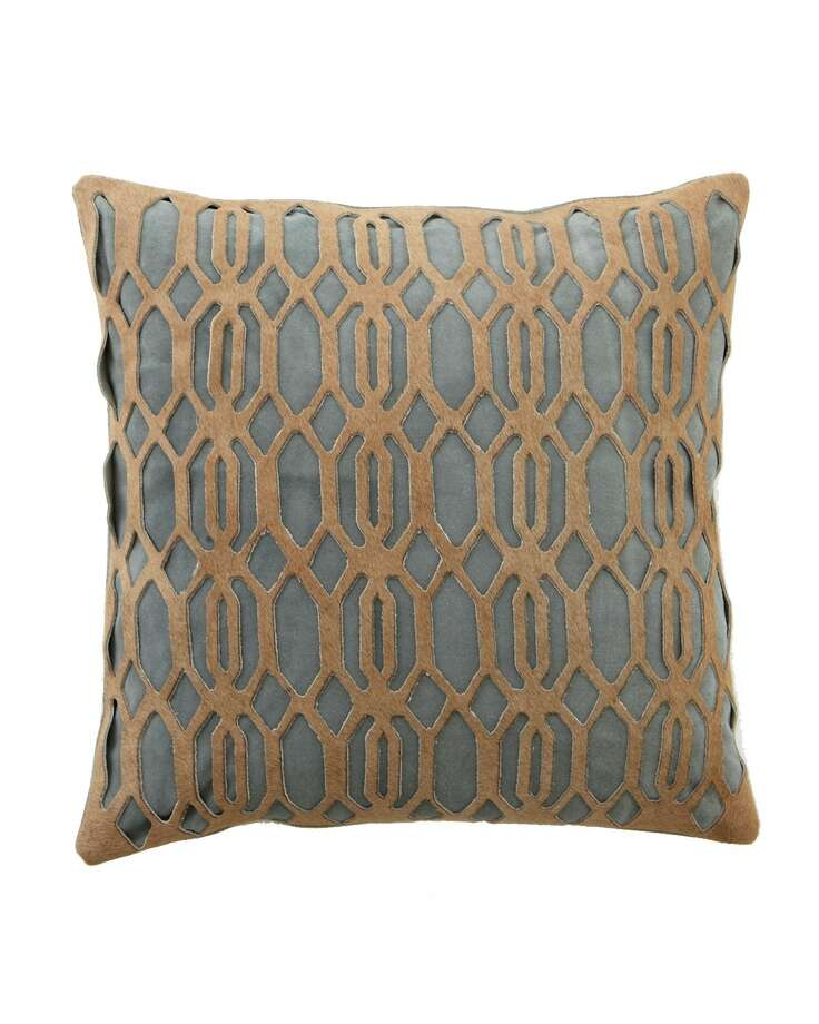 What's sexier than suede? Try the Link pillow byJamie Young, which adds an extra layer of intricately cut hide on top, creating a multidimensional look that has to be seen (and touched) to be believed; $275 at Neiman Marcus.