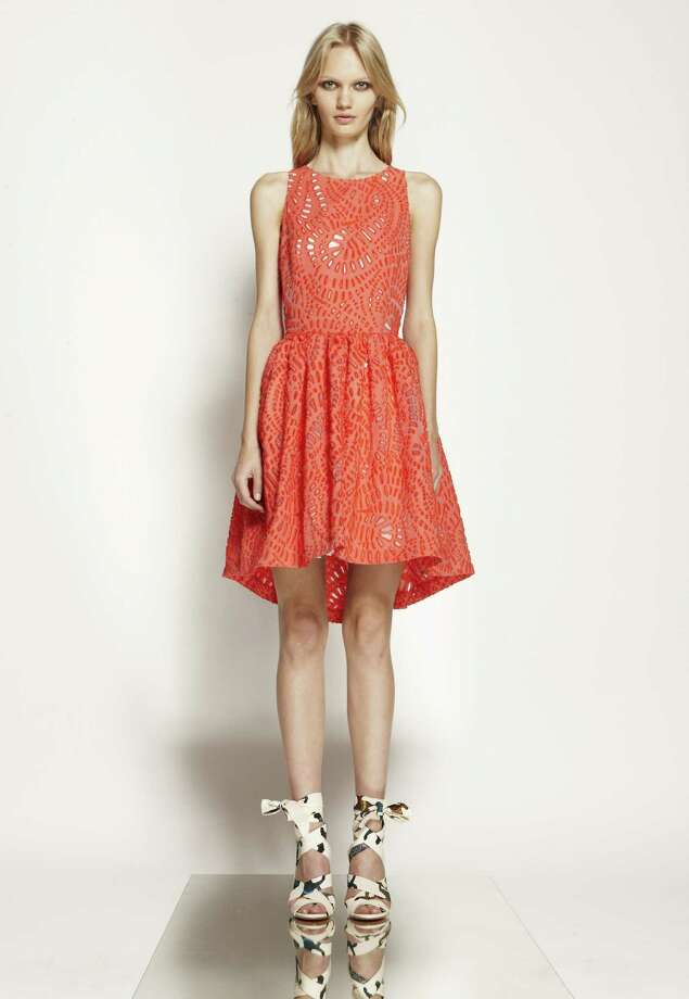 As tart and sweet as a grapefruit, this flirty frock by Italian house MSGM is covered in a laser-cut paisley print with a flouncy skirt and high-low hem for maximum adorableness; $800 at Tootsies.