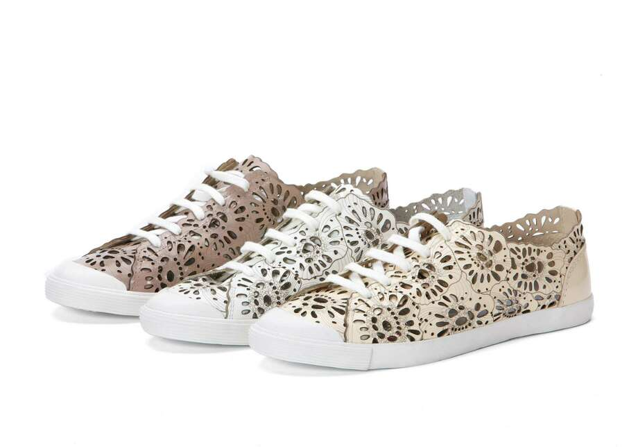 The new line of shoes by beauty heiress Aerin Lauder mixes pretty and practical with floral cut-out patterns on tomboyish sneakers in style-forward nude tones; $148 at