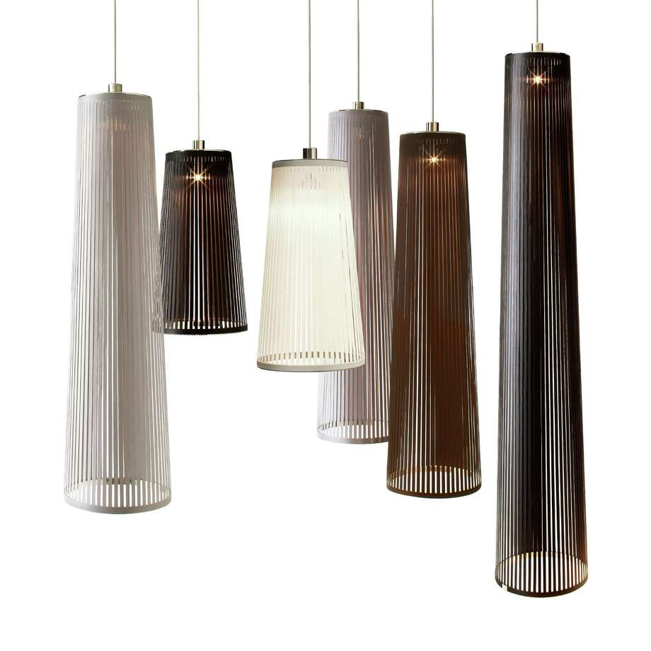 The ribbons of light produced by the Solis lamps were designed by Carmine Deganello to mimic the sun's rays; $300-$500 at Design Within Reach.