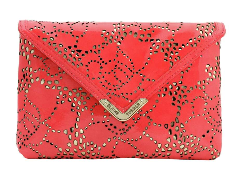 Elaine Turner's best-selling Bella bag is ready for spring with a pop of coral-colored leather and floral patterned peeks of gold; $225 at Elaine Turner.