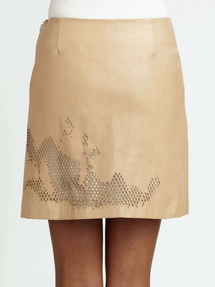 The artful cut-outs create an organic, amoeba-like texture that extends around the hem of Halston Heritage's nude leather skirt; $645 at Saks Fifth Avenue.