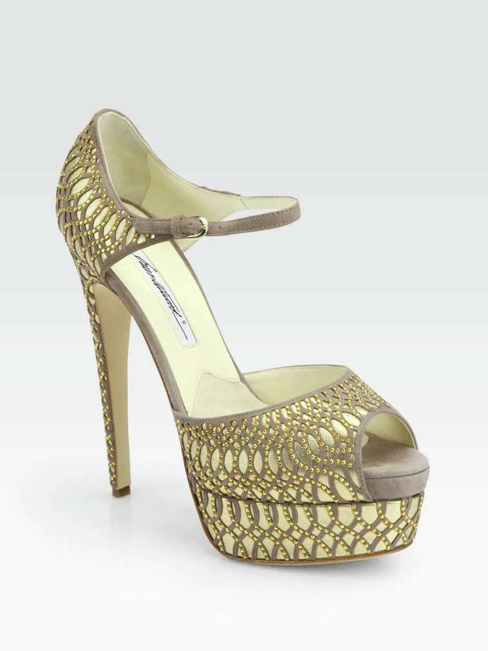 Intricate criss-crosses of gold metallic studs and neutral suede detailing create an opulent pattern of suede, leather and metal on Brian Atwood's dramatic Tribeca platform heels; $1,695 at Saks Fifth Avenue.