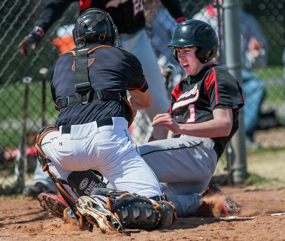 Stamford high school catcher Chris Dipietro tags out Fairfield Warde high school's Thomas Luckner at the plate in a boys baseball game played at Warde high school, Fairfield, CT on Wednesday April 17th, 2013. Photo: Mark Conrad / Connecticut Post Freelance