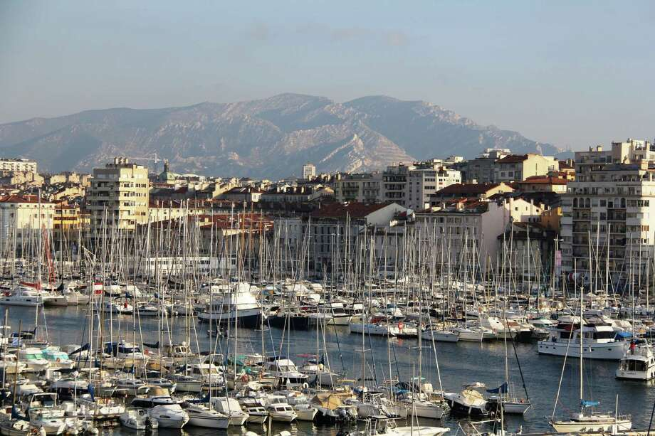 The Marseille harbor is shown with a backdrop of mountains. There are an abundance of happenings in the second largest city in France this year. Photo: Leah Larkin